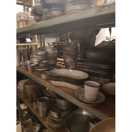 Lots of metal cutlery and plates